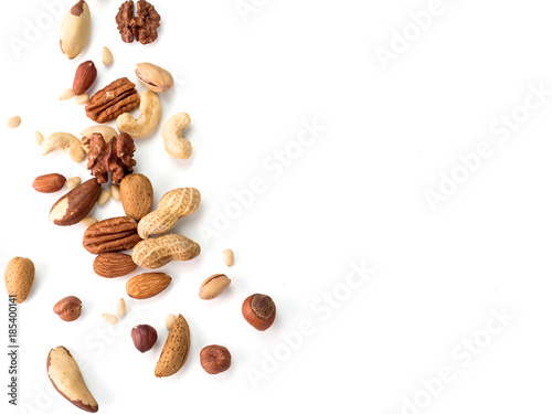 obraz lub plakat Background of nuts - pecan, macadamia, walnut, almonds, hazelnuts, and other - with copy space. Isolated one edge. Top view or flat lay
