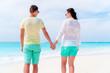 Happy family of two enjoy beach vacation