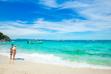 Chon Buri, THAILAND - December 21, 2017 : People are swimming at the beach at the sea and the beautiful sky.