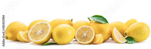 Fotografía Lot of lemon fruits with lemon leaves isolated. Horizontal photo.