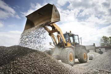 Excavator moving sand