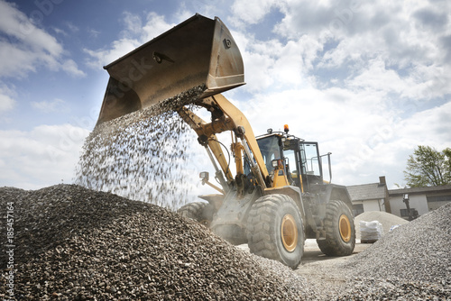 Fotografie, Obraz Excavator moving sand