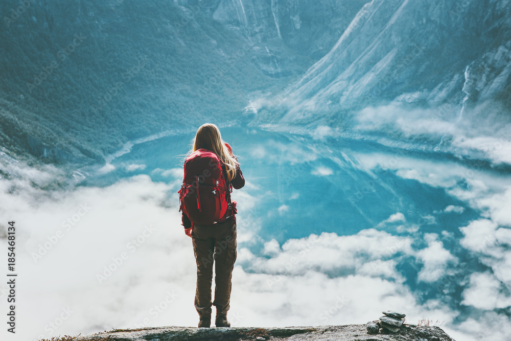 Fototapety, obrazy: Woman tourist enjoying lake aerial view Travel Lifestyle adventure concept backpacker in Norway mountains vacations wanderlust outdoor above clouds