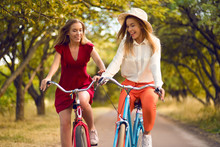 Beautiful Sisters Riding Bicyc...