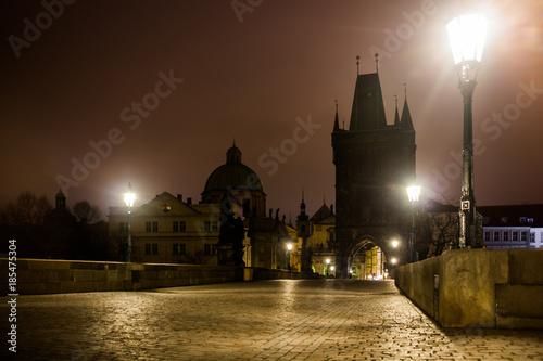 Cuadros en Lienzo Charles bridge in Prague with lanterns at night