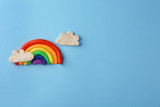 Fototapeta Tęcza - Plasticine rainbow with clouds on color background