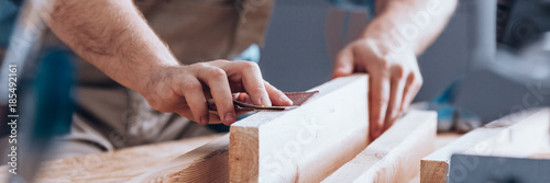 Photographie Sandpaper being used by woodworker
