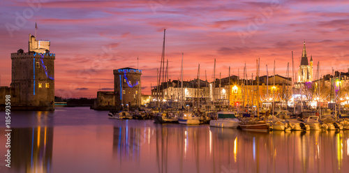Canvas Prints Coral La Rochelle - Harbor by night with beautiful sunset