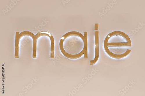 433bc28f4 The Maje logo sits inside an outlet of the luxury clothing store ...