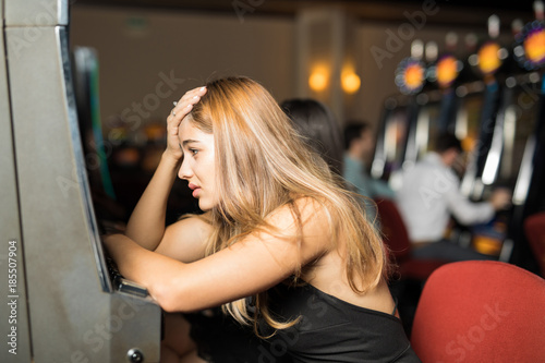 Fotografie, Obraz  Stressed woman in a slot machine