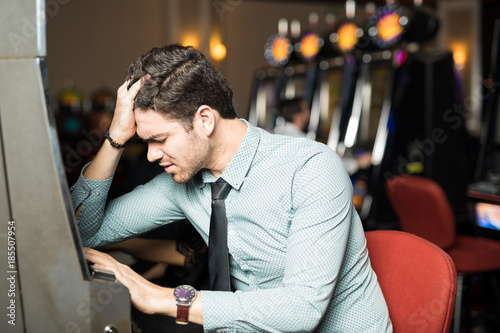 Photo  Man losing money in a casino