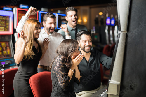 Poster  Excited woman winning in a casino