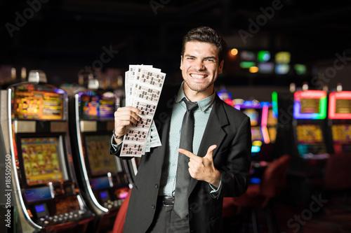 Foto op Aluminium Las Vegas Hispanic man winning at a lottery