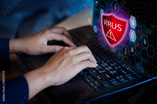 Fotografía  Press enter button on the keyboard computer Protective shield virus red Exclamat