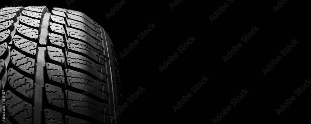 Fototapety, obrazy: car winter tyre on black  background. vehicle wheel pneumatic