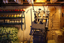 Machine For Manufacturing Wooden Shoes Klompen In Holland. National Traditional Dutch Wooden Shoes. Clog And Klomp Production Workshop.