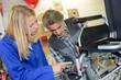 Mechanic working on wheelchair