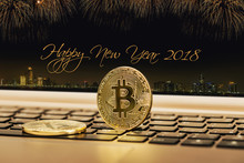 Happy New Year 2018 With Fireworks Background. Celebration New Year 2018. Close Up Golden Bitcoin Coin Crypto Currency Background Concept.