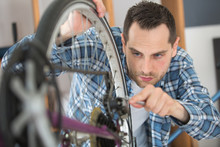 Man Working On Bicycle Chain