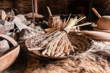 Bundle Of Wheat In A Basket In A Replica Iron-age Dwelling