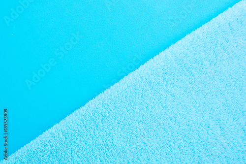 Diagonal Background Of Two Types Of Blue Fabric Smooth And Fluffy