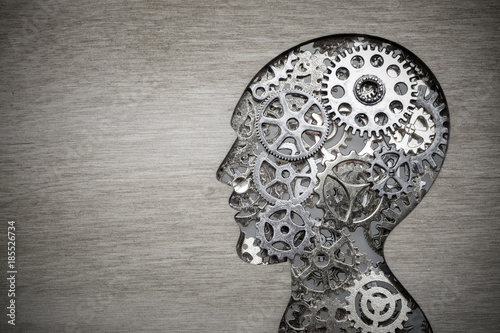Brain model concept made from gears and cogwheels on wooden background Wallpaper Mural