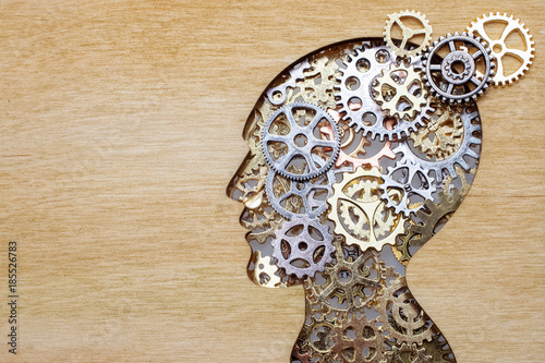 Photo Brain model concept made from gears and cogwheels on wooden background
