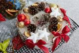 Fototapeta Do akwarium - Christmas decorations pine cones, stars and baubles.