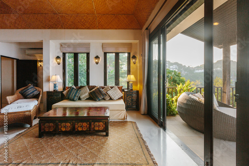 Tropical luxury villa interior, living room with sea view veranda Fototapet