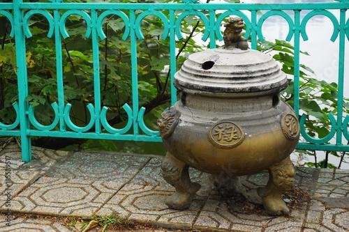 Valokuva  Ancient stoneware urn in Hanoi, Vietnam
