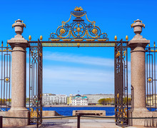 The Large Gates Of The Summer Garden In St. Petersburg, View From The Garden To The Neva Embankment