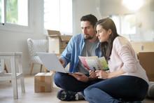 Couple Choosing Paint Colours To Reform House