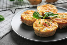 Plate With Tasty Egg Muffins On Table, Closeup