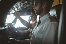 Pilot And Copilot Flying An Ai...