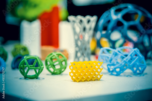 Many abstract models bright colorful objects printed on a 3d printer on a white table Canvas Print