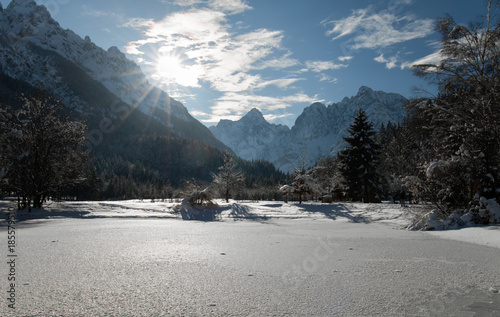 Stickers pour porte Pierre, Sable scenic view on wonderful frozen lake jasna in julian alps in blue sky, kranjska gora, Slovenia