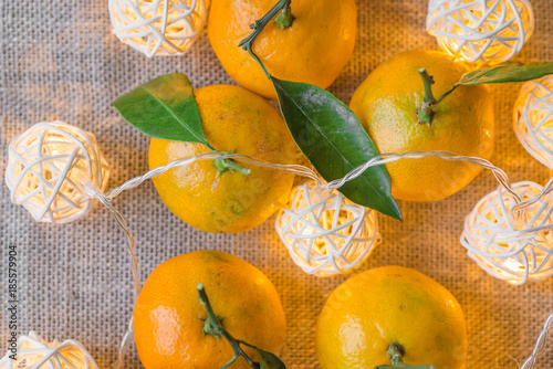 Tangerines and Christmas garlands glow