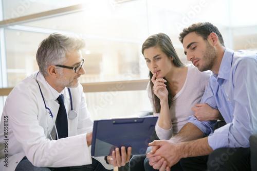 Valokuva  Couple meeting medical specialist at hospital