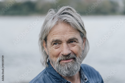 Attractive senior enjoying being outdoors, portrait