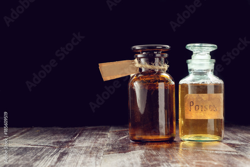pair of apothecary bottles with potion of poison or tincture Canvas Print