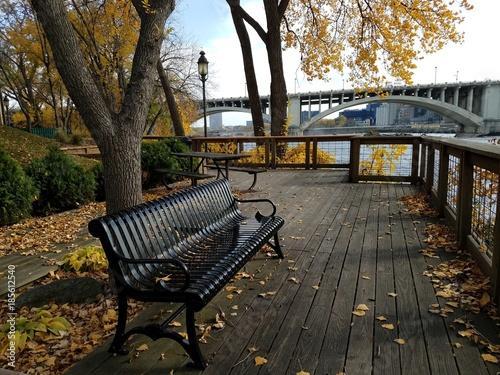 Pleasing Metal Black Park Bench With Yellow Autumn Tree Buy This Creativecarmelina Interior Chair Design Creativecarmelinacom
