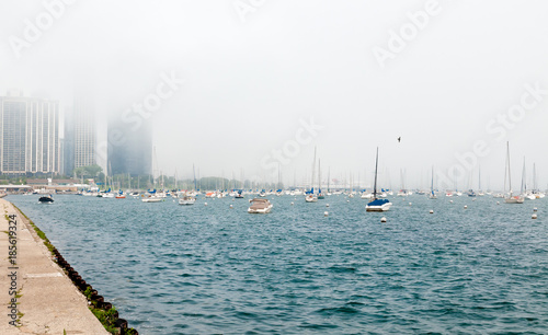 Coast of Lake Michigan in the fog with parked boats. Landscape for background.