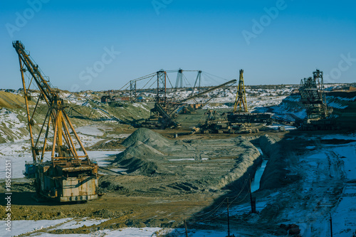 Poster Amusementspark Production of manganese ore in the largest field in Europe. Open development. Huge machines of manganese ore mined in open pits. Metallurgical industry in Ukraine, Nikopol district.