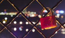 Red Padlock With Heart Shape On It In Front Of The City Lights. Romantic Scene.