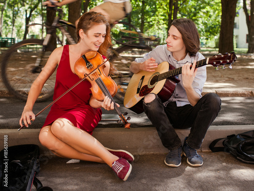 street music duo group performing in a park Poster