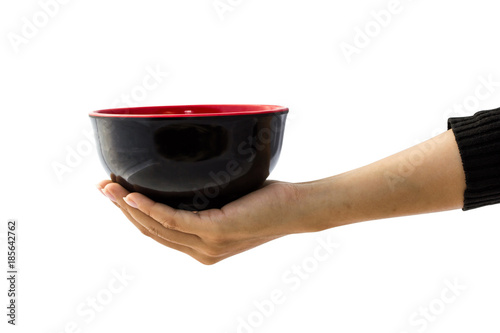 Female hand holding empty black bowl isolated on white background with clipping path for graphics, cut out, editing Wallpaper Mural