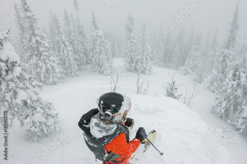 Fotobehang Wintersporten Man standing at top of ridge. Ski touring in mountains. Adventure winter freeride extreme sport