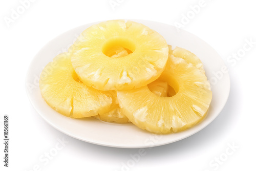 Canned pineapple slices on plate