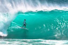 Local Surfer Riding Big Wave At Padang Padang Beach, Bali, Indonesia