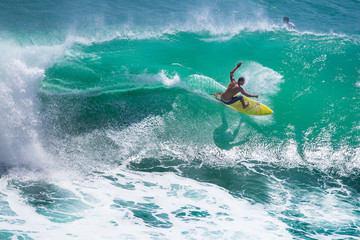 Fototapeta Surfer riding big green wave at Padang Padang beach, Bali, Indonesia